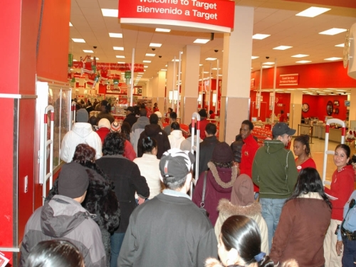 A crowd shuffles into Target at the DCUSA mall in Columbia Heights. Photo by Gridprop on Wikimedia.