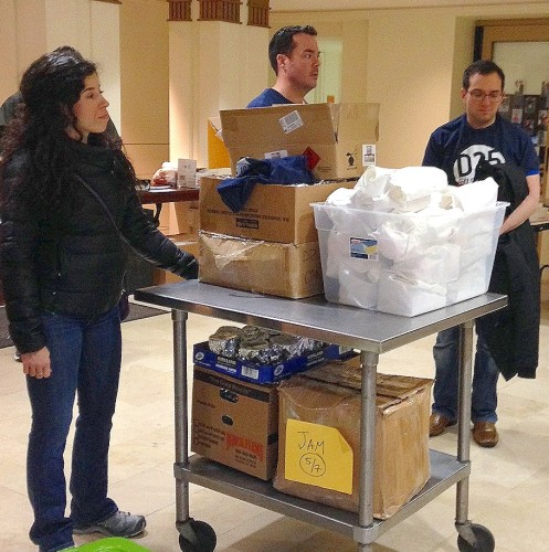 Participants in the Jews and Muslims DC event prepare to leave the DC Jewish Community Center with food and gifts for homeless people on Christmas Day.