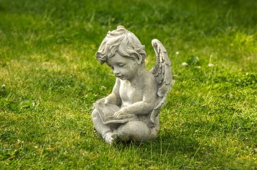 angel/cherub statue reading a book on the grass - https://pixabay.com/en/the-statue-of-angel-art-boy-1398281/