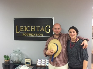 "Couple stands at sign reading ""Leichtag Foundation"""